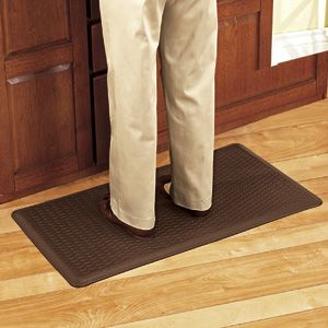 """COMFORT MAT - BROWN. Deluxe, ergonomic anti-fatigue mat reduces stress on feet, knees, legs and back! This 5/8"""" thick foam mat provides supreme cushioning and comfort while reducing the strain caused by standing on hard surfaces. Perfect for use in your kitchen, laundry room, garage - virtually any hard surface area. The attractive basket-weave patterned surface is stain-proof and super easy to clean and maintain. Features a slip-resistant bottom. Made in the USA. 20"""" W x 36"""" L"""