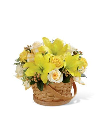 The FTD® Sunny Surprise™ Basket is the perfect way to delight your special recipient in honor of any of life's special occasions or for no special reason at all! Yellow roses, cream roses, yellow LA hybrid lilies, peach hypericum berries and lush greens are beautifully arranged in a woven woodchip handled basket to create an incredible gift intended to spread happiness with each sunlit bloom.