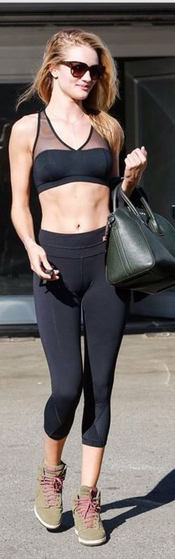 Who made  Rosie Huntington-Whiteley's mesh sports bra, green handbag, and high top sneakers?