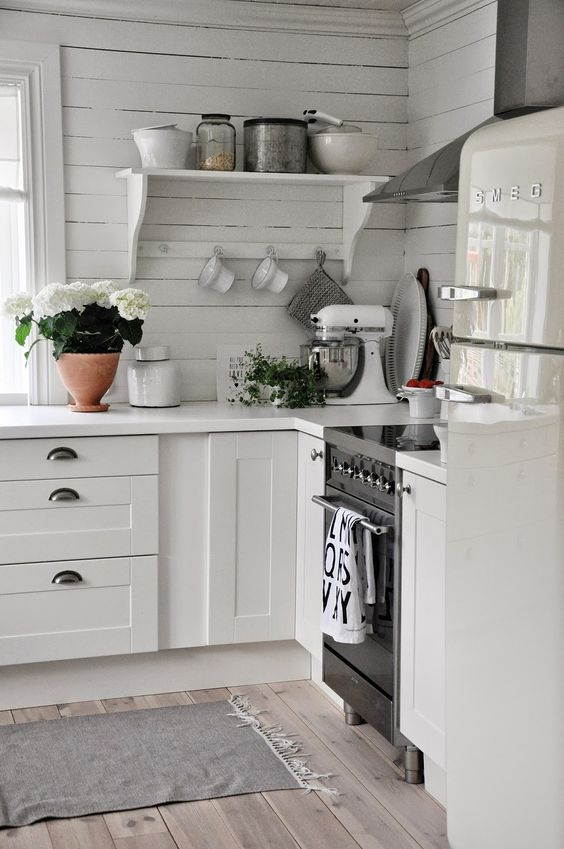 Love the clean space-saving cottage kitchen design. The shelf with with bracing bar across for holding cups or stabilization.: