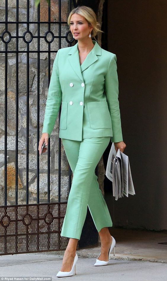 Commute: Ivanka Trump smiled confidently as she left her house for work on Wednesday morning in a pastel green pantsuit and white pointed-toe pumps