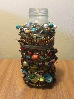 DIY- an easy way to keep your bracelets is to stack them on a bottle or jar.