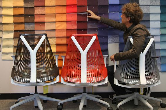 Yves Behar in the Herman Miller material library, finalizing fabrics for the SAYL family.