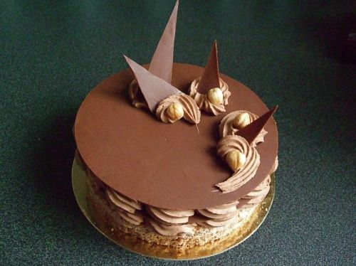 """Douceur Chocolat… also known as """"Heavenly Chocolate"""" – hazelnut dacquoise, a layer of crispy praline, milk chocolate mousse, and milk chocolate disks."""
