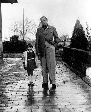 Audrey with her father in Linkebeek, Belgium, 1933.: