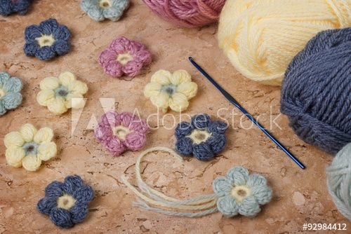 Handmade colorful crochet flower with skein