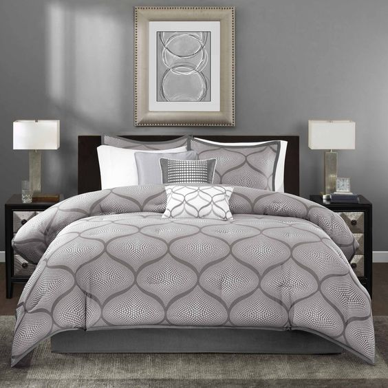 The Madison Park Vella Comforter Set uses a woven jacquard fabrication to create a unique ogee design. The charcoal grey background provides the perfect base for the silver faux sequin motif.: