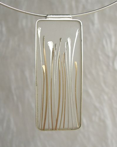 Carla Pennie Mcbride seed pendant of sterline, gold fill and resin