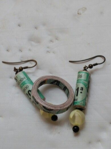 Pendientes y anillo con billete de loteria del niño