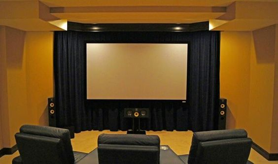 Floating cinema screen over a wall of velour curtains a simple solution to add a presence to - Home theater screen wall design ...