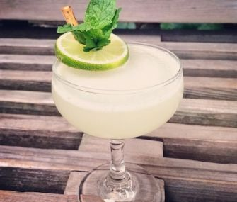 French Pearl Cocktail | ¾ ounce fresh lime juice  ¾ ounce cane syrup 1 sprig spearmint  2 ounces Plymouth Gin ¼ ounce Pernod Classic Pastis Lime and mint for garnish