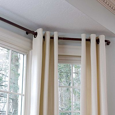 Bay Window Curtain Rods - spendy, but I think could create them with plumbing parts spray painted with metallic toned paint.