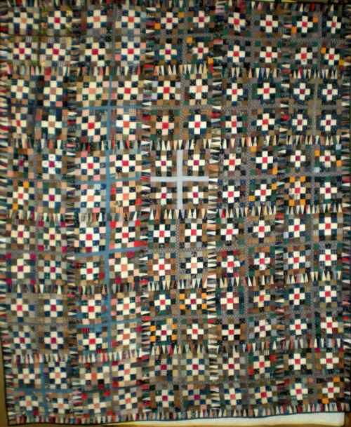 """Postage Stamp.  Late 1800's quilt top newly hand quilted by 92 year old Opal Baum of OKC. From the collection of Dorothy Greenfeather.  72"""" x 82"""""""