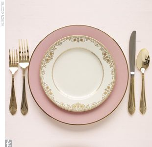 Here is a Pair larger pale pink plates for the main course with salad plates with delicate gold detailing for an elegantly understated combination for a gold and pink wedding.