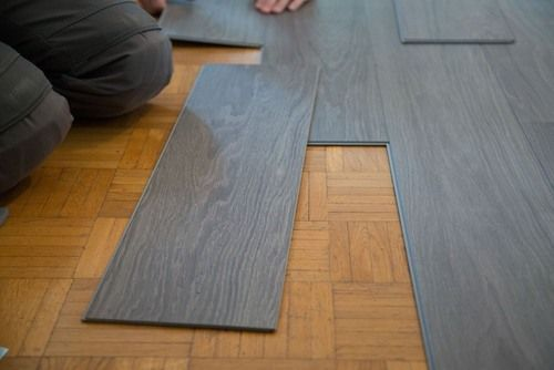 Vinyl Vs Laminate Flooring Pros Cons Comparisons And Costs Vinyl Vs Laminate Flooring Flooring Vinyl Flooring