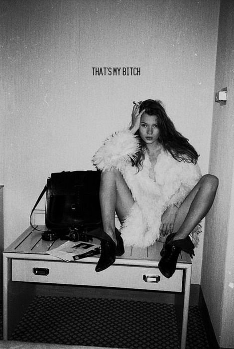Kate Moss in the coolest leather booties, looking so 90s and fulfilling the heroin chic craze with the contrast of dark to light and her placement on a grungy table.                                                                                                                                                      More
