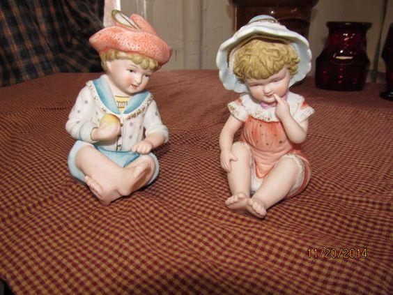 Vintage Antique Bisque Porcelain piano dolls boy girl Design Reg 6682 by EvenTheKitchenSinkOH on Etsy