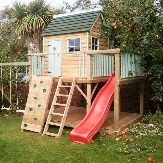 Architecture: Fascinating Cool Playhouses Ideas For Your Kids, Cool wooden playhouse with wooden stairs, climbing boards and red slider