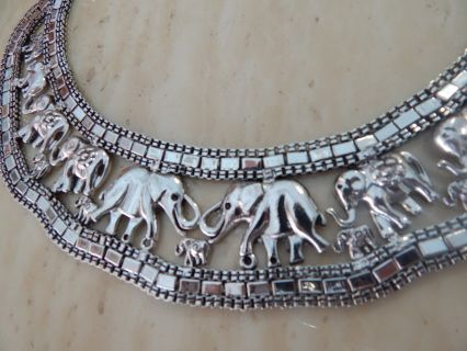 Elephant Necklace 18-20 inches in Silvertone.  Very impressive.  Not heavy. All our jewelry are packaged in clear protective bags with beautiful blue boxes.    Free Shipping Gift Box