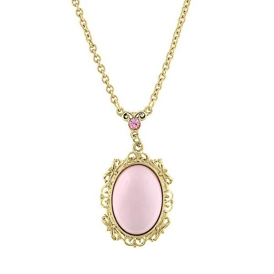 Chic and elegant perfectly describe this pastel pink oval shaped pendent necklace. Elegantly surrounding the pendant is a combination of bright brass bows and vines that effortlessly compliment this chic neutral pink color. It is surely to become the go-to piece of your jewelry collection.