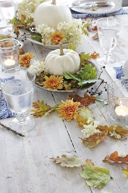 centerpiece: white pumpkins on plates w/ leaves & flowers