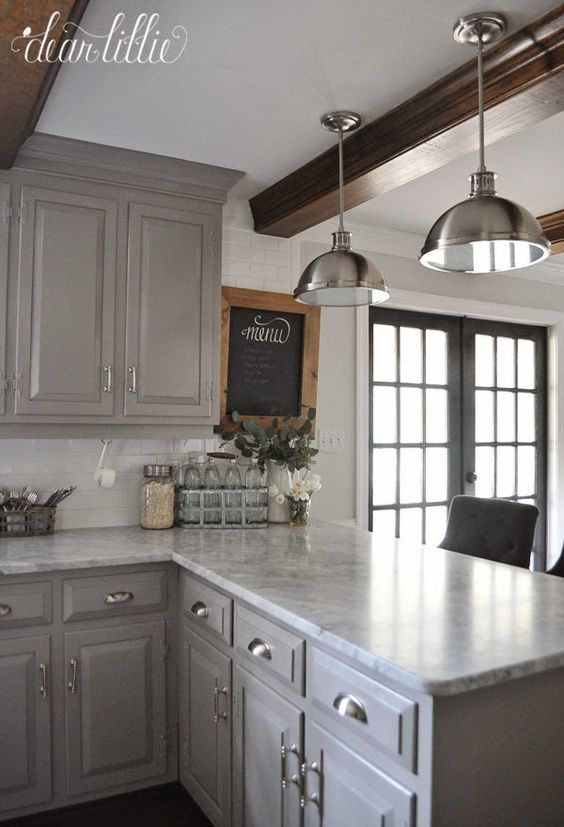 Love the light gray cabs and counter tops, white subway tiles. Love the dark french doors with white trim .: