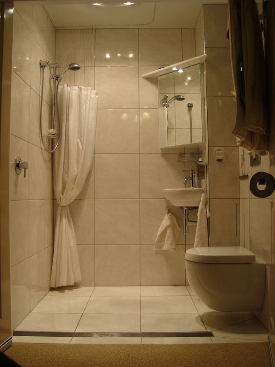 Disappearing shower curtain for small bathrooms small for Nice small bathrooms