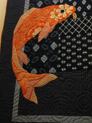 Hand appliqued Koi on kasuri background by Julie Fukuda at My Quilt Diary
