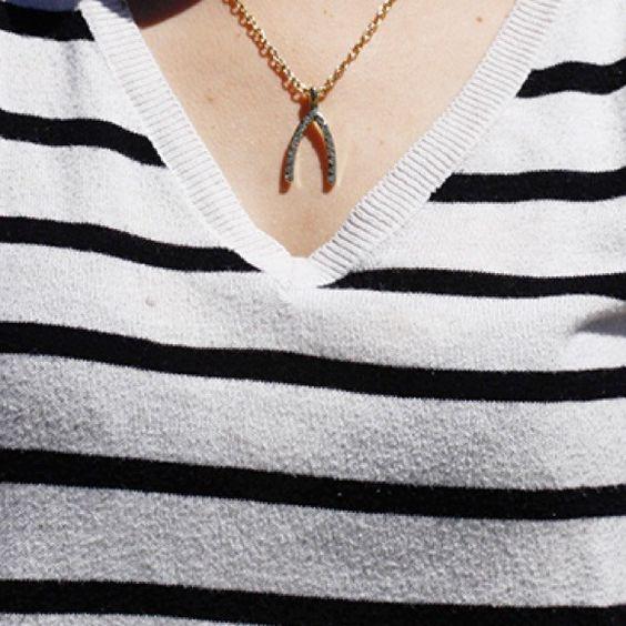 "Rhinestone Wish Bone Necklace Silver necklace with a rhinestone wish bone charm. Approximately 19"". Jewelry Necklaces"