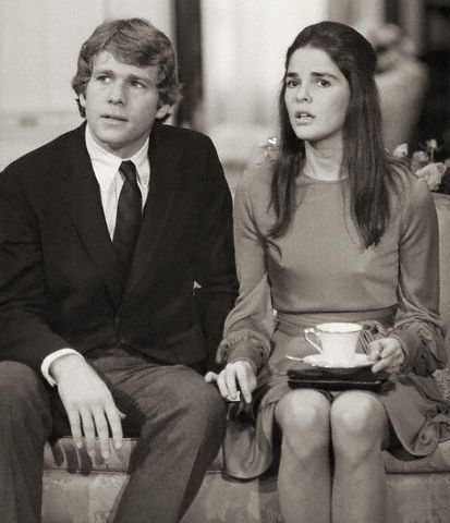 Ryan O'Neal and Ali MacGraw looking worried in a scene from the 1970 Paramount film, Love Story, in which they star as ill-fated lovers.: