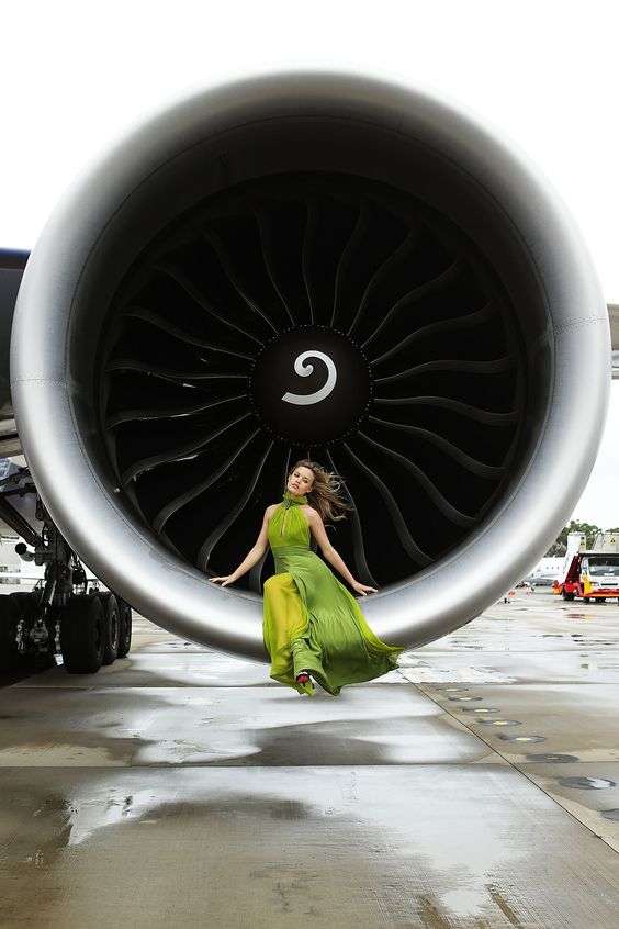 British Airways 777 High Tea Event Georgia May Jagger poses inside an engine of the new British Airways Boeing 777-300ER aircraft in Sydney, Australia. (Image via Brendon Thorne/Getty Images for British Airways)