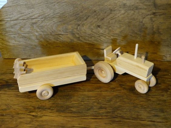 Wooden toy tractor and ground driven manure spreader