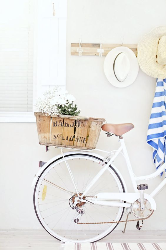 love a white bike a nautical stripe and old beach hat and a french basket don't you ;)
