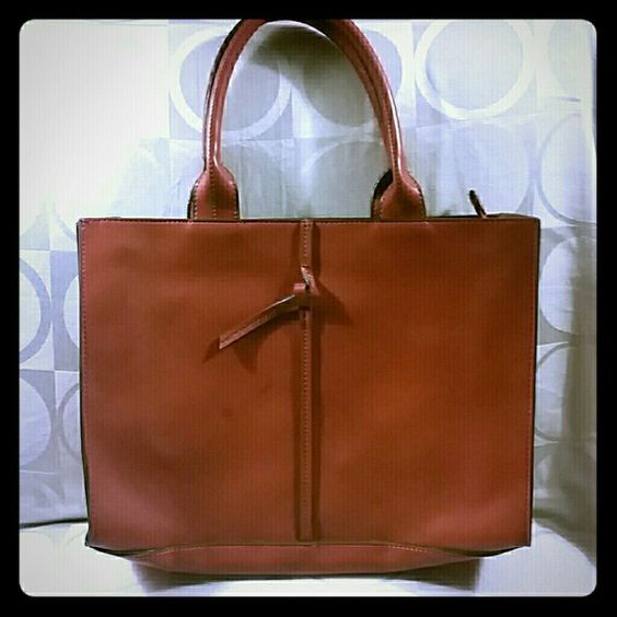 Deep Orange Square Briefcase Bag Vintage Bag. Nice Style. Measures 14 inches wide 10 inches deep and has straps. Purse is not made of Genuine Leather. Vintage Bags