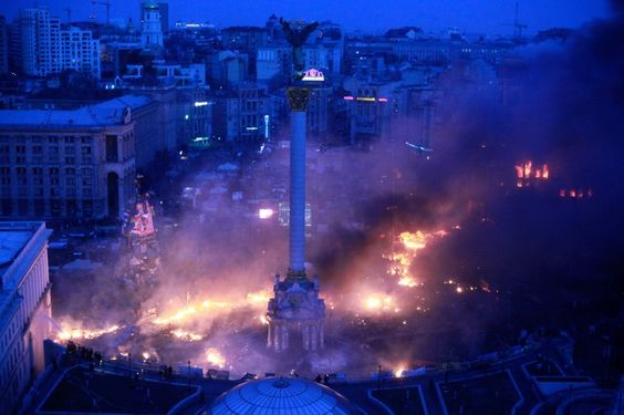 Smoke rises above Independence Square during anti-government protests in central Kiev in the early hours of February 19, 2014.