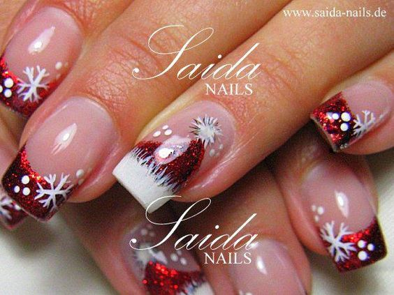 Christmas Nails. Snowflakes on red French manicure