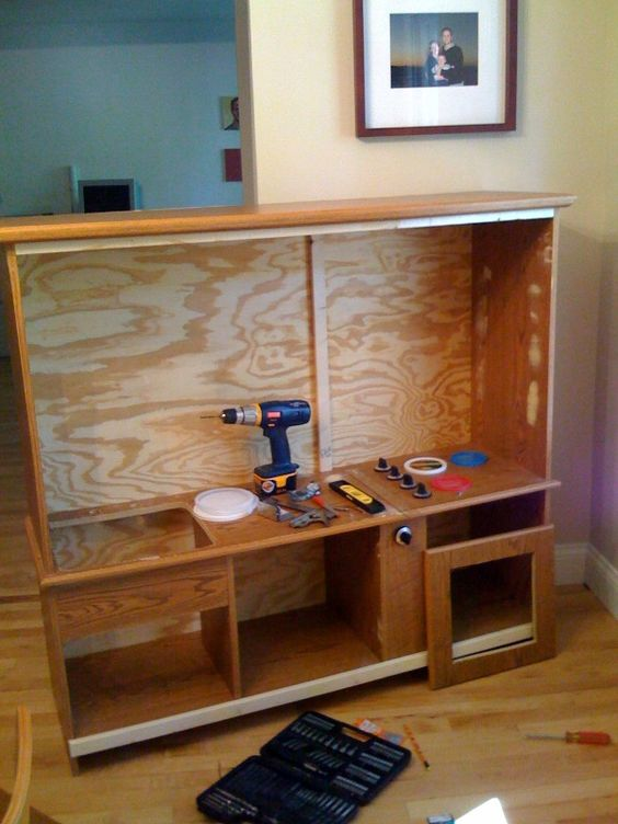 This is one creative Dad!  Old TV stand turned play kitchen....check out the site!