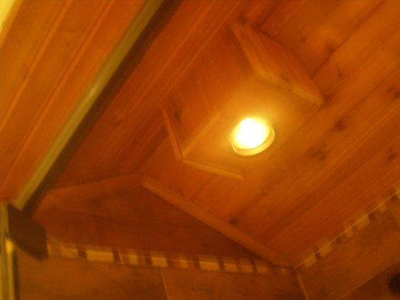 Vaulted shower ceiling with cedar siding.