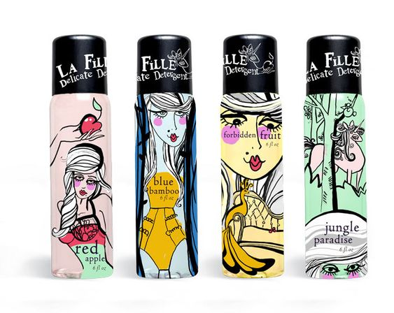 La Fille, or the girl in French, seduces with the lure of a fantastical world.    Rococoesque imagery, flamboyant and risque, meldswith the purity of The Garden. Most women can relate to the opposingideals of temptation and innocence. Choose from a variety of scents. All of the type used in this piece is from, or hand-done and based on,the LTC Cloister Family.