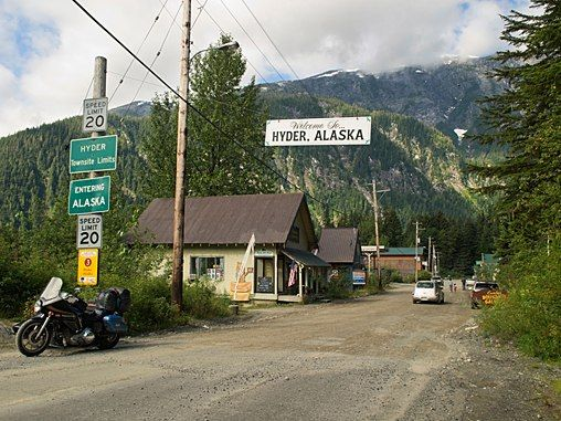 """Hyder, population 87, is Alaska's easternmost town, a tiny town surrounded by lofty, glacier-covered peaks at the corner of the Alaska Panhandle. The town boomed in the early 20th century when gold and silver were discovered nearby, but is now so small that residents bill it as """"Alaska's friendliest ghost town."""" The ferry to Ketchikan, the nearest Alaskan city, stopped running more than a decade ago."""