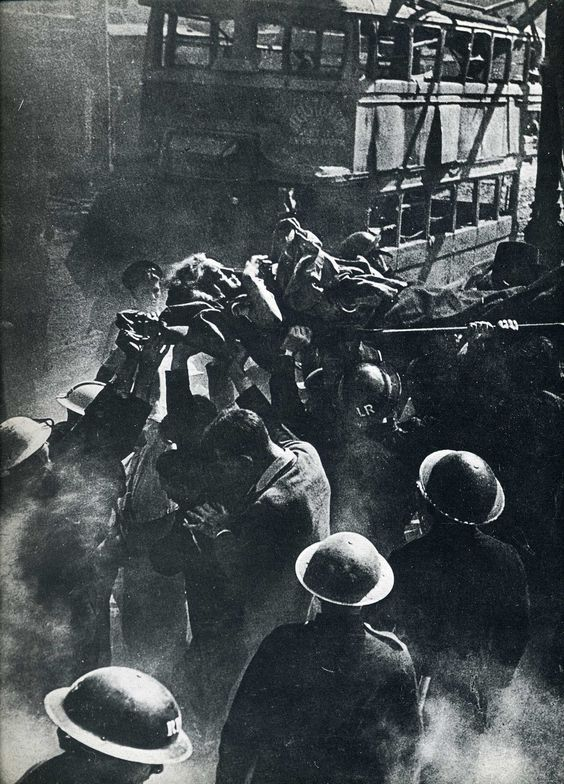 London At War-rescue workers helping pull victim from ruins of a building hit by