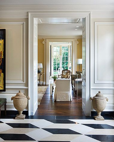 Pretty entry. Black white and beige diamond floors