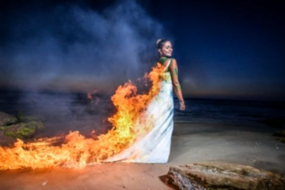 "Instead of preserving their wedding gowns and stowing them in the back of their closets, many adventurous brides are choosing to destroy their dresses (using water, paint or even cake) for increasingly popular ""Trash the Dress"" photo shoots. But one recent Trash the Dress shoot has some wondering if the trend has gone too far."