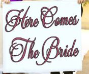 Here Comes the Bride....Wedding Banner, have your flower girl or ring bearer announce you.  http://shop.chapelrunners.com