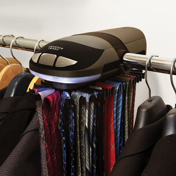 Shops a button and the o 39 jays on pinterest for Motorized tie racks for closets