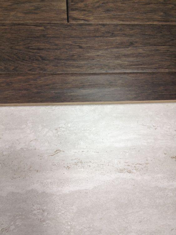 Grey hardwood floors next to light grey tile avondale for Wood floor next to tile