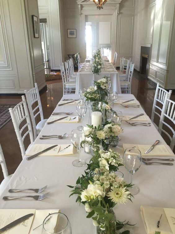 Green and white garland for long rectangle wedding table