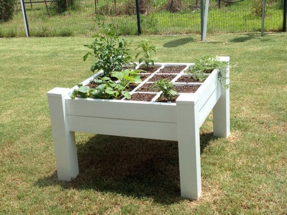 A raised garden bed with legs table heighth by GardenTable