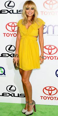 Nicole Richie in a short yellow dress from Keepsake
