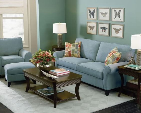 The Blue Green Wall And Light Blue Couch Create A Relaxing